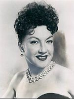 "Ethel Merman (January 16, 1908 – February 15, 1984) was an American actress and singer. Known primarily for her powerful voice and roles in musical theatre, she has been called ""the undisputed First Lady of the musical comedy stage."" Among the many standards introduced by Merman in Broadway musicals are ""I Got Rhythm"", ""There's No Business Like Show Business"", ""Some People"", ""Rose's Turn"", ""I Get a Kick Out of You"", ""It's De-Lovely"", ""Friendship"", "" She did not need a microphone to be heard"