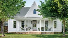 Charming Tennessee Mountain Cottage - Smart House - Ideas of Smart House - Check out this charming Carpenter-Gothic-style cottage and the smart ways its Monteagle Tennessee owners outfitted it to live large. White Farmhouse Exterior, Southern Farmhouse, Farmhouse Design, Modern Farmhouse, Farmhouse Style, Southern Living, Farmhouse Windows, Farmhouse Renovation, Victorian Farmhouse