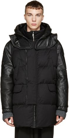 fe3b2ac3bb3 Long sleeve quilted down coat in black featuring grained leather paneling  throughout. Detachable hood in