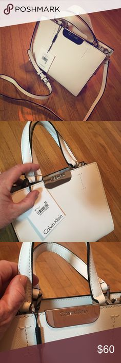 Calvin Klein Handbag NWT Pristine Calvin Klein Eggshell Handbag sure to be the hit of any outfit. I purchased this beauty in New York City on an impulse and never used it. It's roomy enough for day use and classy enough for evening. Calvin Klein Bags Mini Bags