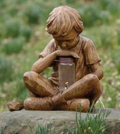 Boy with Firefly Statue