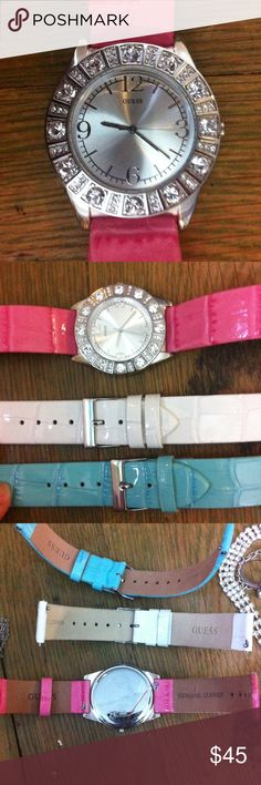Guess watch NWOT watch Beautiful guess watch with 3 interchangeable bands. Pink, white and pale blue. Watch still has plastic protector on it. Guess Accessories Watches