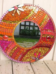 Round mosaic mirror, the suppport is wooden. Glass paste glazes , glass marbles and cracked glass for this mirror red and orange. the dimension is and for just the mirror There is a tie on the back Send by USPS Mosaic Tile Art, Mirror Mosaic, Mosaic Crafts, Mirror Art, Mosaic Projects, Mosaic Glass, Mosaics, Glass Art, Sea Glass