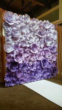 Ombre purple paper flower wall. Made this for the ceremony for the wedding…