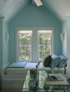 Beautiful window seat/ day bed in this Lake Michigan cottage designed by Kathryn Chaplow (via House of Turquoise blog)