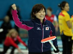Ayumi Ogasawara of Japan celebrates after Japan won an end during Curling Women's Round Robin match between Japan and Russia during day 6 of the Sochi 2014 Winter Olympics at Ice Cube Curling Center