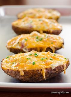Ingredients 2 large potatoes low calorie spray sea salt black pepper 4 slice of cooked lean bacon, chopped 4 tablespoons of fat free sour cream  56g of cheddar cheese fresh chives
