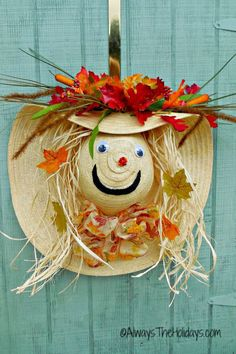 Turn a floppy straw hat with a wide brim into a cute scarecrow that will greet guests with a friendly face.  Get the tutorial at Always The Holidays.    - CountryLiving.com