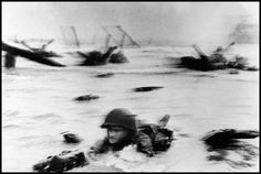 <b>1944</b> | In the face of devastating German fire, American troops land at Omaha Beach on D-Day, June 6, 1944. Originally published in the June 19, 1944, issue of LIFE.