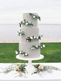 gray wedding cakes with green flowers