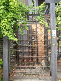 Old bed spring garden gate... I am seeing this as a trellis for climbing vines...