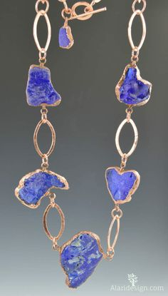 "This is a beautiful cobalt blue sea glass nugget necklace, electroformed in copper, with brushed copper chain.  The glass was melted in a fire at the time of its disposal pre 1960, then later was eroded into the ocean where it was tumbled by the surf.  I was lucky to get 7 pieces of this extraordinary glass, 6 are used in this necklace!  The total length of the necklace is 38"" but could be made shorter... This is an unique statement necklace.... $119.00"