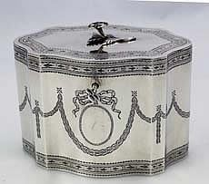 "George III Style Sterling Tea Caddy by Howard & Co  A pristine hand engraved sterling silver tea caddy made about 1900 in the George III style. Superb recessed hinge and original cast finial. The original sterling silver key works. Bright cut bands and swags with garlands on both sides. Ht: 4"" Width: 5 1/2"". Wt: 12.3 troy ounces."