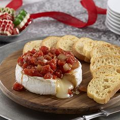 Savory Tomato Baked Brie THIS IS A WONDERFUL DISH TO HAVE ON HAND. IT IS SO EASY TO MAKE AND DELICIOUS TO EAT WITH TOASTED SLICED BREAD OR YOUR FAVORITE CRACKERS. MAKE THIS TODAY, YOU WILL BE SO GLAD THAT YOU DID...ENJOY