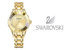 """Alegría Reloj, Gold Tone Diseñado con nuestro exclusivo bisel de cristal facetado, este reloj elegante y de tendencia aporta un toque de brillo sutil a los looks de diario. La caja y la correa están magistralmente elaboradas en acero inoxidable con revestimiento en tono oro amarillo, que combina con el bisel de cristal dorado y con la sofisticada esfera iridiscente. Caja de 33 mm; sumergible hasta 50 m; denominación """"Swiss made"""". Swarovski  www.elretirobogota.com"""