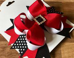 Beautiful designed bespoke hair bows & tutus by TotallyBowsCo