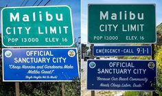 Official-looking signs boasting Malibu's sanctuary city status