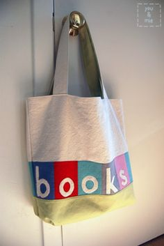 sewable or fabric projects for book lovers! bookbag, bookmark, fabric-covered journals, etc.