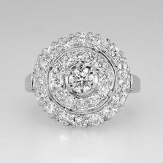 This vintage heavy platinum bulls eye ring can either be a fabulous cocktail ring, or a sparkling engagement ring! The diamonds are all a well