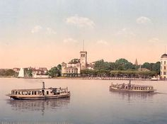 Boats at Uhlenhouster Ferry, Hamburg. This color photochrome print was made between 1890 and 1900 in Hamburg, Germany.