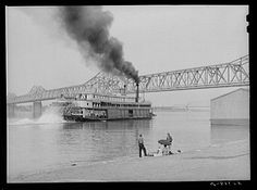Riverboat carrying cargo leaving dock along waterfront on Ohio River. Louisville, Kentucky | Library of Congress