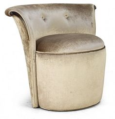 DEVONSHIRE  This elegant low-back pouf with subtle tufting and delicate carving adds a touch of femininity to any room.