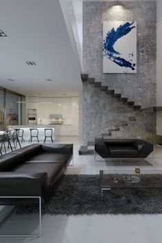 Inspiring Examples Of Minimal Interior Design 3 - UltraLinx | modern industrial loft with concrete walls and contemporary stairs | large black leather couches | large oversized artwork | modern residential interior design