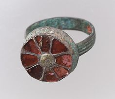Finger Ring  Date: 500–550 Culture: Frankish Medium: Gold, garnet, mother-of-pearl