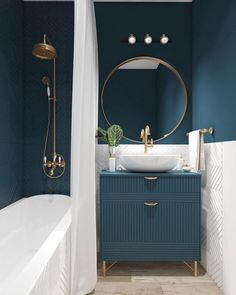Bathroom ideas blue teal superfront vanity unit and round mirror with brass taps and a white bathtub #toiletandbathroomdesign