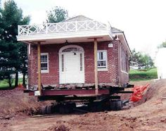 This Historical brick schoolhouse was moved away from the street to allow the town to create a broader intersection without interfering with school grounds Building Movers, House Lift, Raised House, House Movers, Flood Insurance, Protecting Your Home, Good House, New Brunswick, Moving House