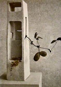 "Isamu-Noguchi-ceramic-sculpture -- Isamu Noguchi's 'Lonely Tower"" - Shigaraki stoneware with thin ash glaze make in 1952 - with ikebana by Teshigahara Sofu"