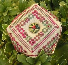 Cross stitch biscornu with pretty button