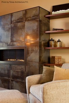 The black tile fireplace offsets the grey paint job surrounding this welcoming living room.