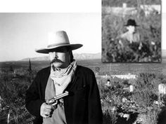 """This photo was shot at Boothill Cemetery in Tombstone Arizona by Terry Clanton, cousin of the legendary Clanton Gang who shot it out at the OK Corral. Clanton says """"This is the photo that changed my opinion about ghost photos. The picture was shot in black & white, because my friend wanted an old western style picture of himself dressed up in my 1880 period clothes. I know there was no other person in this photograph when I shot it, especially some guy holding a knife!""""."""