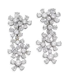 PAIR OF DIAMOND 'FLORA' EARRINGS, BULGARI  Each surmount designed as a floral cluster supporting an articulated pendant of trailing flowerheads, set throughout with pear shaped and round brilliant cut diamonds together weighing 22.99 carats, mounted in platinum, signed BVLGARI,