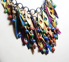So shaggy and colorful...I would not be able to stop myself from fiddling with this necklace throughout the day...