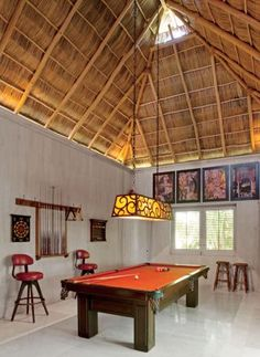 Exotic Media/Game Room by Martyn Lawrence Bullard in Punta Mita, Mexico