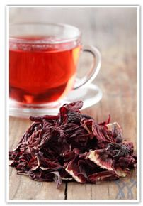 "Hibiscus tea is a tisane or ""herbal tea"" consumed both hot and cold by people around the world. The drink is an infusion made from crimson or deep magenta-coloured calyces (sepals) of the Hibiscus sabdariffa flower. It has a tart, cranberry-like flavor. The tea contains vitamin C and minerals and is used traditionally as a mild medicine."