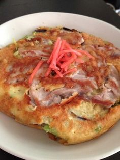 """""""Okonomi-yaki,"""" a Japanese vegetable and meat pancake recipe, using less flour and adding grated potatoes. Quite tasty, and great for using leftover vegetables for dinner."""
