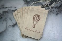 """Wedding favor bags, muslin, 3x5. Set of 50. Hot air balloon and """"Love is in the air"""" in brown on natural white cotton.. $50.00, via Etsy."""