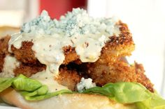 Hot Wing Pork Chop Sandwich with Spicy Blue Cheese Cream Sauce. I need to try this!