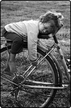 Photo toddler asleep on bike. Cute!