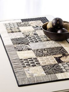 "Create a quick runner and matching place mats using precut 10"" squares."