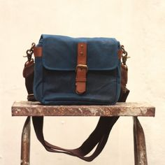 Gouache Holga Bag (Royal Blue) water repellant inside and out, adjustable straps, adjustable padded divider, 1 magazine pocket, removable straps, fits iPad mini and other small cameras. 100% cotton canvas, genuine leather
