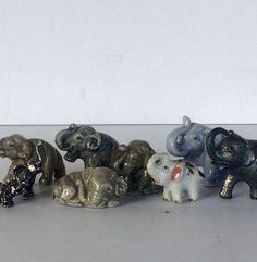 Mid Century Nine Elephants Figurine Miniature by StoreFourandMore. Wonderful instant collection. All nine Elephants for this low price.