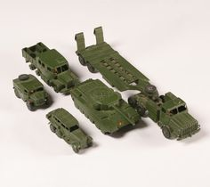 "Dinky military toys; flatbed carrier with tank, three trucks. 12"" long. Good condition, tires off one truck."