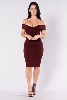 - Available in Burgundy and Black - Ribbed Dress - Fitted - Knee Length - Surplice V Neckline - Cap Sleeve - Made in USA - 95% Polyester 5% Spandex