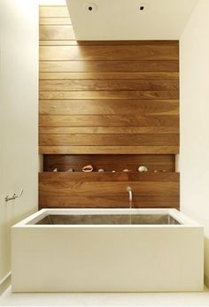 modern bathrooms - Japanese inspired bath with horizontal wood-paneled tub wall – Aidlin Darling Design via Atticmag
