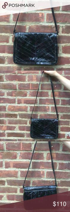 Vintage Eel Skin Black Bag Vintage Eel Skin Black Bag. Genuine Eel Skin. Black design. Made in Korea. Zippered pockets. Really gorgeous!! Vintage Bags Crossbody Bags