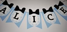 Pretty Alice in Wonderland-themed banner in the traditional colors of light blue, white, and black. This banner can be personalized however you